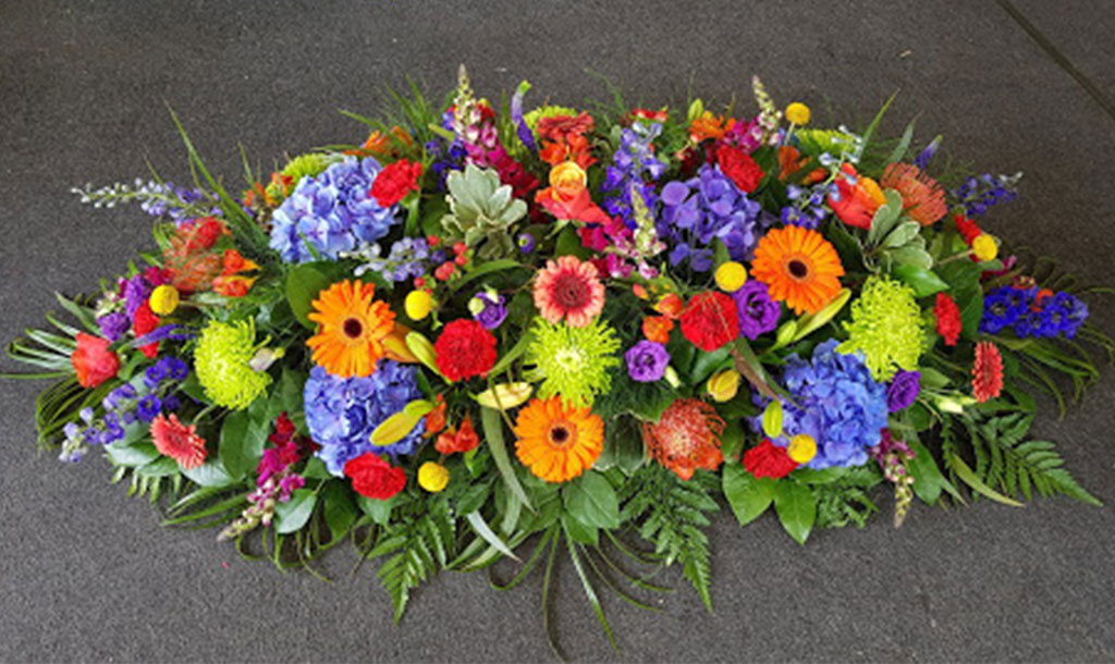 Colourful Spray Funeral Flowers